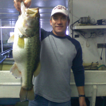 Steve Schiele with a Trophy Large Mouth Bass at Lake Lewisville Fishing Barge