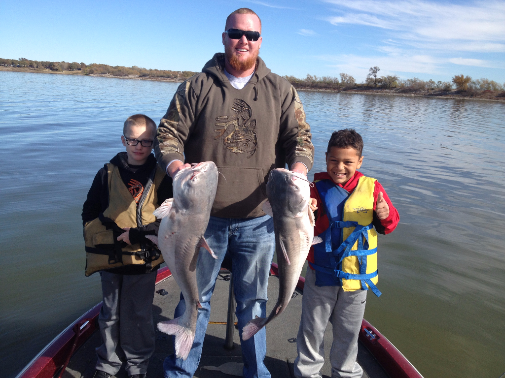 Kids and Dad with Trophy Blue Catfish caught on a guided Lake Lewisville fishing trip