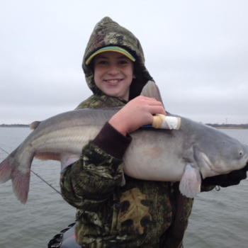 Kid with Trophy Blue Catfish caught on a guided fishing trip