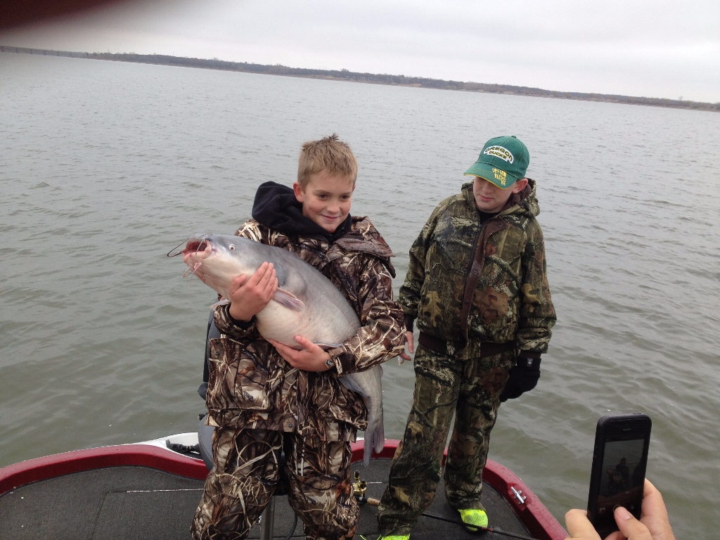 Kids with a Big Blue Catfish caught on a guided Lake Lewisville fishing trip
