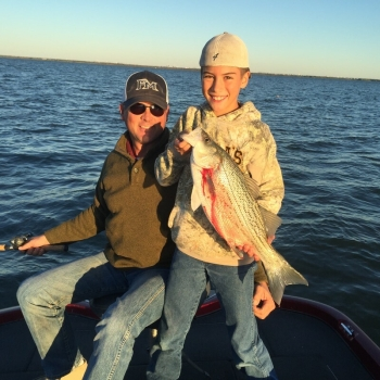 Father and Son fishing Lake Lewisville for Hybrid Bass