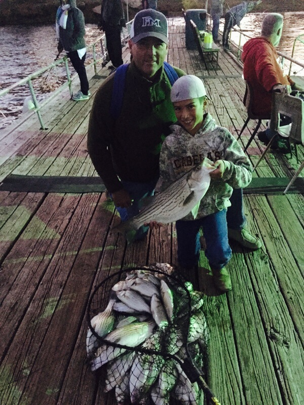 Kids fishing hybrid bass and sand bass Photo at Lewisville Fishing Barge